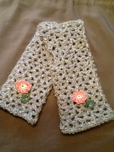 Pearl grey handwarmers with delicate pink flowers.